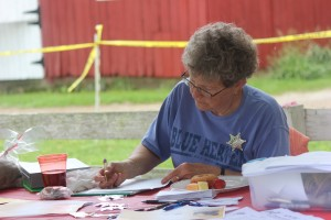 ANTA president Peggy Metcalf at the registration table.